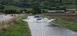 car driving through flooded road.JPG